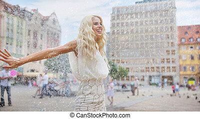 Woman dancing in the rain