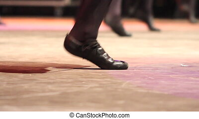Woman dancing Irish dance female feet on stage at folk...
