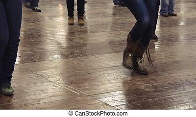 Woman dancing line dance country music cowboy