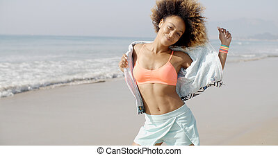 Woman Dancing On The Tropical Beach - Africam american woman...