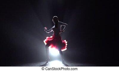 Woman dancing rumba. Slow motion