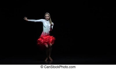 Woman dancing samba dance, dark background. Slow motion