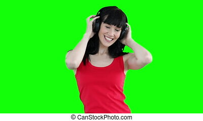 Woman dancing while listening to headphones