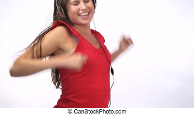 Woman dancing while wearing headpho