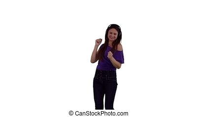 Woman dancing while wearing headphones