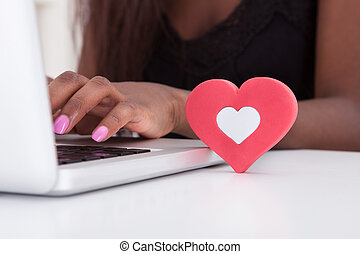 Woman Dating Online On Laptop At Home