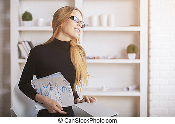 Woman daydreaming in office