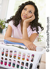 Woman Daydreaming Over Washing Basket