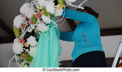 Woman decorate wedding arch