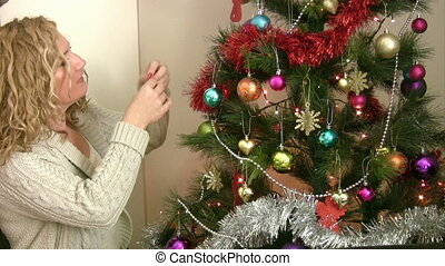 Woman decorating the christmas tree