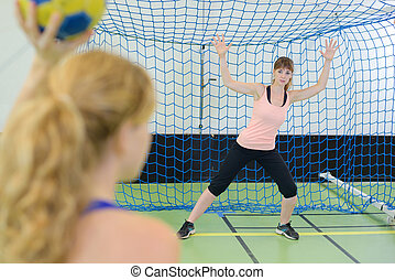 Woman defending handball goal