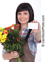 Woman delivering flowers with message