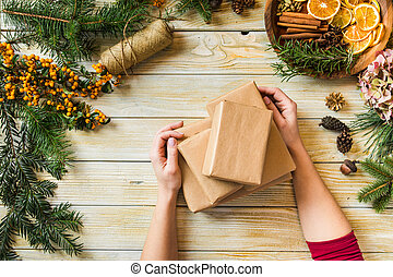 Woman demonstrates the creation of Christmas eco gifts