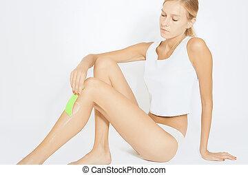 Woman depilate her legs