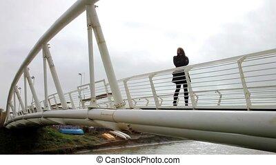 Woman depressed on bridge