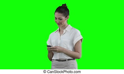 Woman dialing on her phone before looking to her side