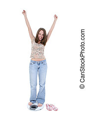 Beautiful Young Woman Standing On Bathroom Scale. Shot in studio with the Canon 20D.