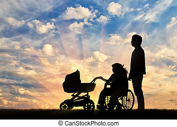 Woman disabled in wheelchair and pram with her husband