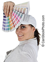 Woman displaying paint swatch