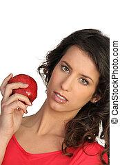 Woman displaying red apple
