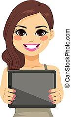 Woman Displaying Tablet - Beautiful brunette woman...