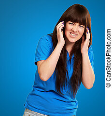 Woman Disturbed By Noise Isolated On Blue Background