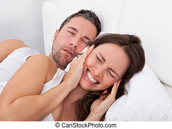 Woman Disturbed With Man Snoring - Frustrated Woman...