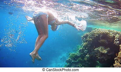 Woman dive underwater in snorkeling diving mask - Beautiful...