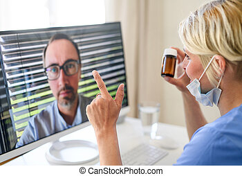 Woman doctor having video call with patient on laptop, online consultation concept.
