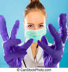woman doctor in face mask and gloves
