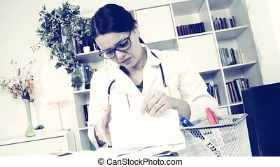 Woman doctor making funny faces