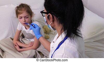 Woman doctor measure girl body temperature