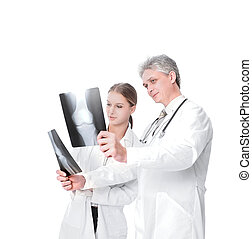 Woman doctor reviewing xrays with colleague. isolated on a white