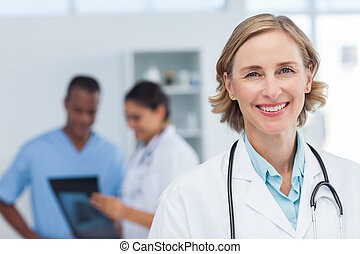 Woman doctor smiling and looking to the camera