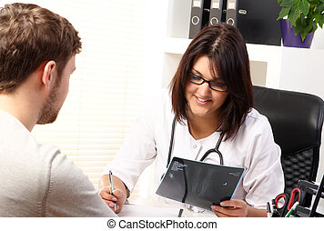 Woman doctor talking with patient