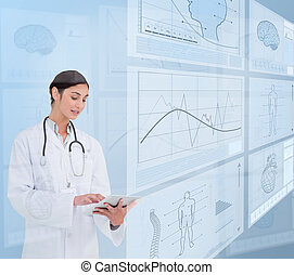 Woman doctor using a tablet pc near to futuristic screens