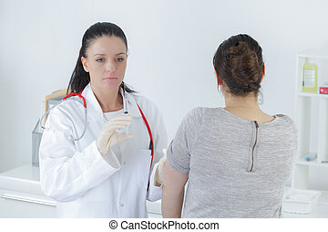 woman doctor with woman patient