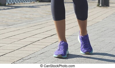 Woman does exercises to stretch footsteps