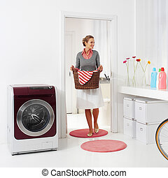 holding basket of laundry
