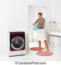 woman doing a housework holding presoak
