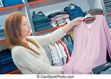 Woman doing a spot of cothes shopping