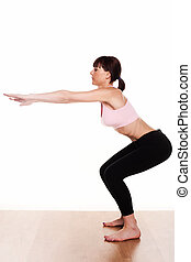 woman doing a squat exercise
