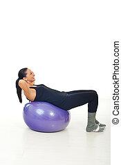 Woman doing abs on pilates ball
