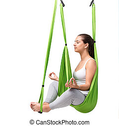 Woman doing aerial antigravity yoga isolated.