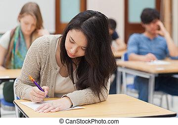 Woman doing an exam