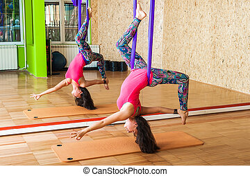 Woman doing antigravity Aerial yoga