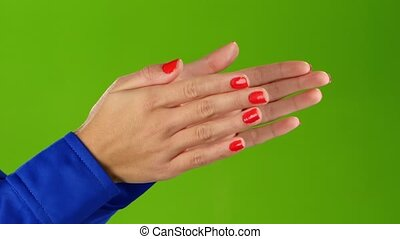Woman doing applause her hands on green screen background....