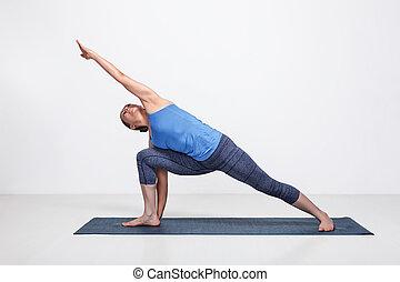 woman doing ashtanga vinyasa yoga asana padangusthasana