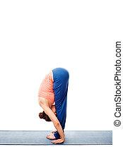 Woman doing Ashtanga Vinyasa Yoga Surya Namaskar Sun...