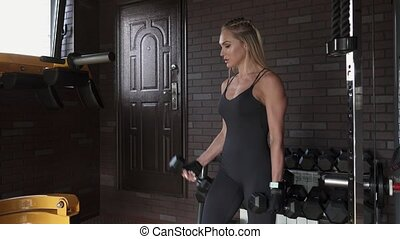 woman doing biceps exercise - Fitness woman doing biceps...